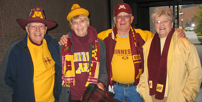Group of alumni in maroon and gold Gopher gear