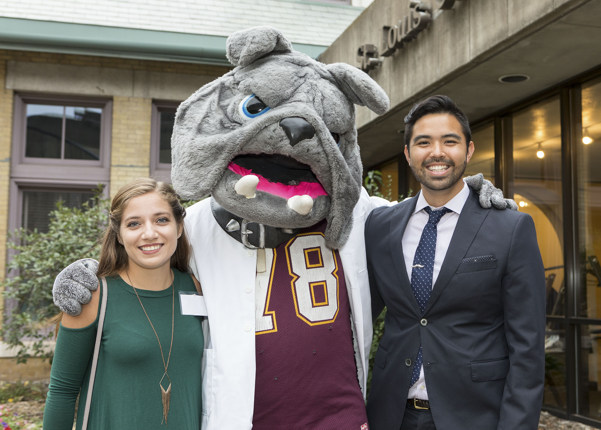 College of Pharmacy alumni posing for a photo with the University of Minnesota Duluth campus mascot