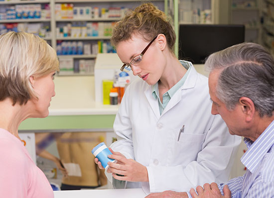 pharmacist consulting with patients