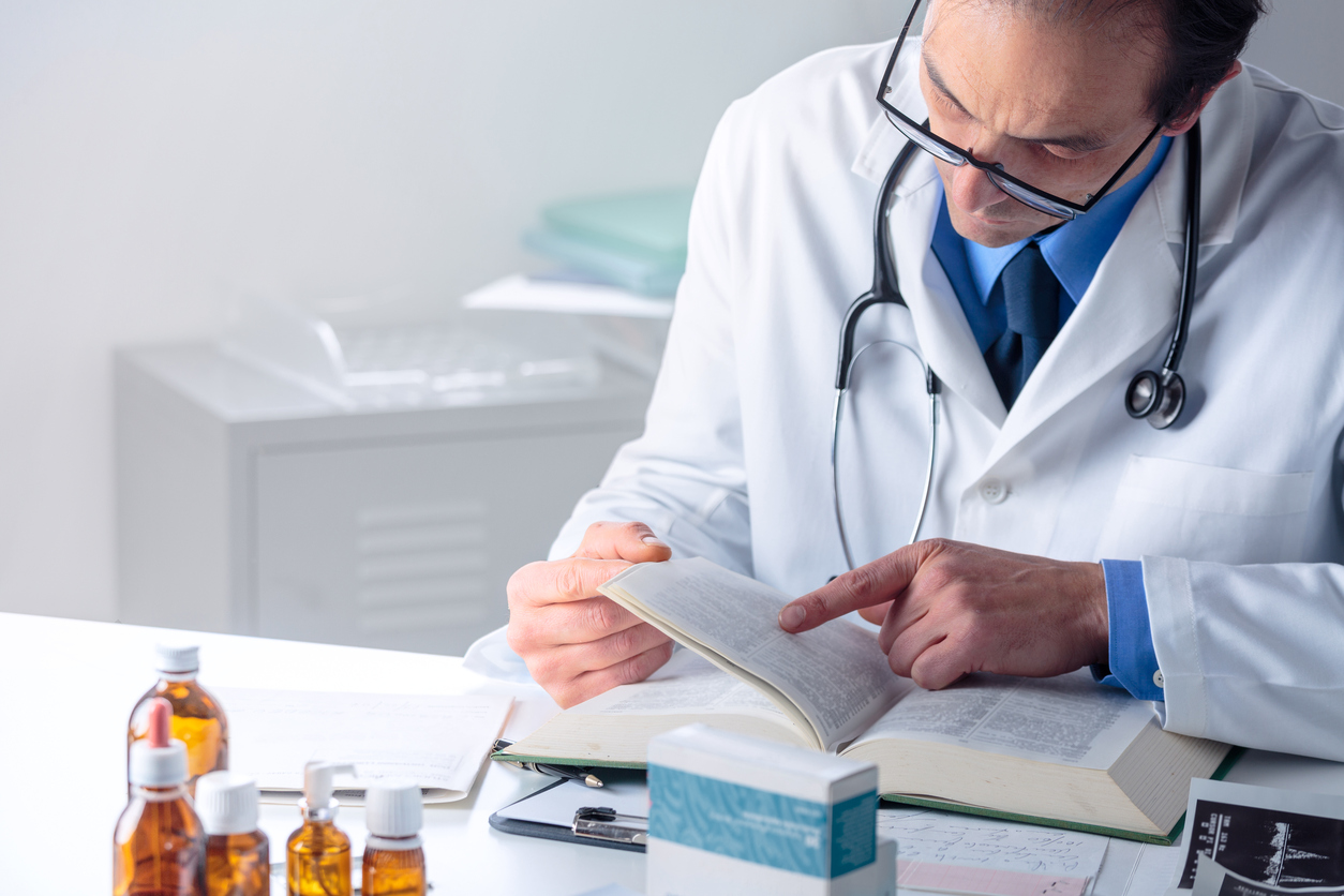 Health care provider examines medical text