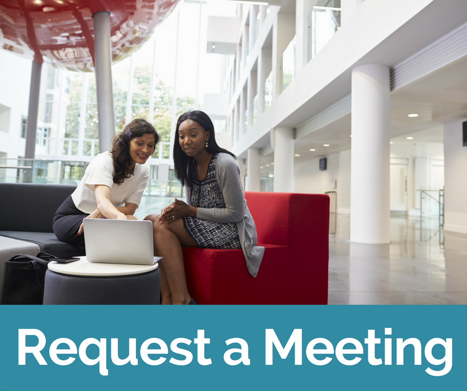 A meeting between two women on campus. Click this link to request a meeting.