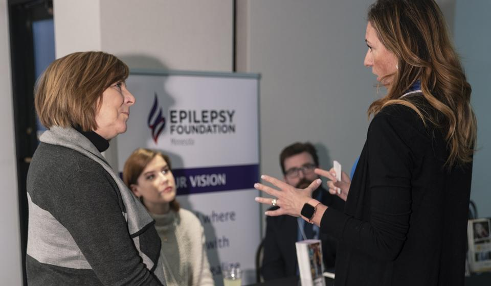 Attendees interacting with representatives from the Epilepsy Foundation of Minnesota.